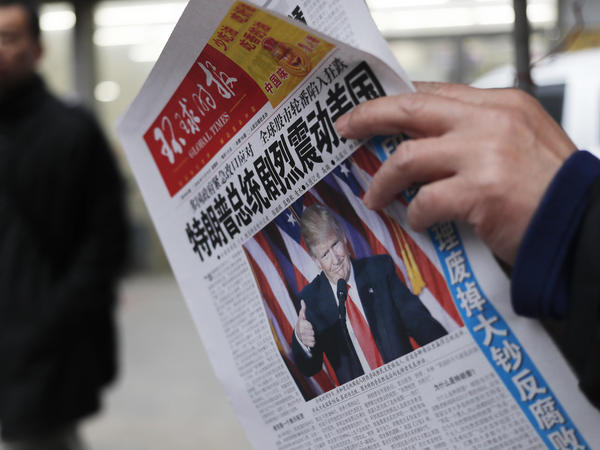 "A Chinese newspaper headline says ""U.S. President-elect Donald Trump delivers a mighty shock to America."" Trump has promised to label China a currency manipulator, which would pave the way to imposing high tariffs on Chinese imports."
