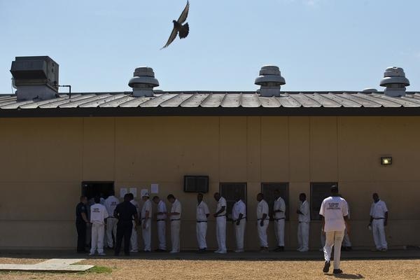 Prisoners stand in a crowded lunch line at Elmore Correctional Facility in Elmore, Ala., on June 18, 2015. A trial starts Monday over conditions in Alabama's prisons.