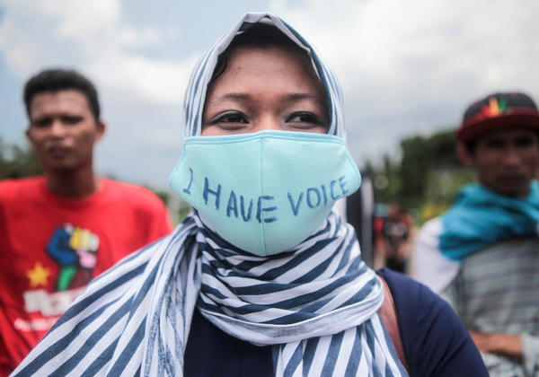 Indonesian activists celebrate International Women's Day in front of the Presidential Palace in Jakarta in 2016.