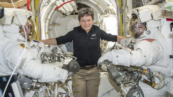 Astronaut Peggy Whitson became NASA's astronaut with the most time in orbit Monday. She is seen here earlier this year, along with fellow astronauts, in the Quest airlock of the International Space Station.