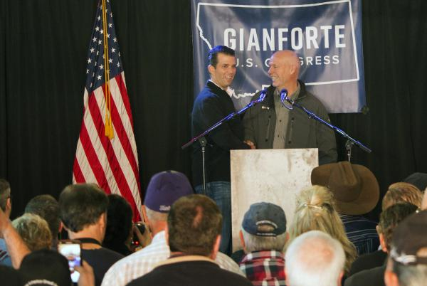 Republican Greg Gianforte (right) welcomes Donald Trump Jr., the president's son, onto the stage at a rally in East Helena, Mont., on May 11. Gianforte, a businessman, is embracing his party's president in his race for the state's open congressional seat.