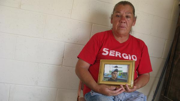 Maria Guereca in her apartment in Juarez, Mexico, holding a picture of her son, Sergio Hernandez the day the Supreme Court news came down. He was killed by a Border Patrol agent seven years ago this month.