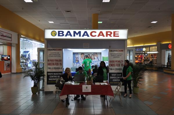 The 2018 Affordable Care Act enrollment period has been cut in half to six weeks. Florida Blue says the law has been a good business. Here, the Sunshine Life & Health Advisors kiosk at Mall of the Americas in Miami awaits sign-ups in 2015.