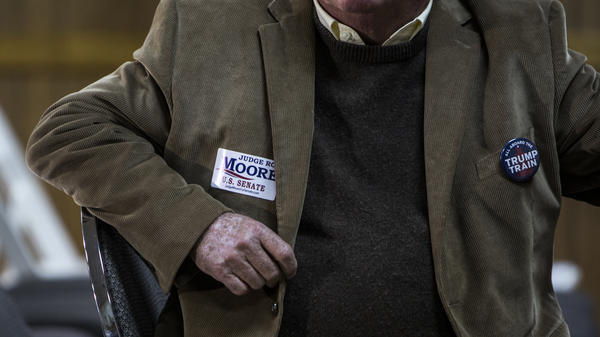Judge Roy Moore supporters wait for a campaign rally to begin on November 27, 2017 in Henagar, Alabama.