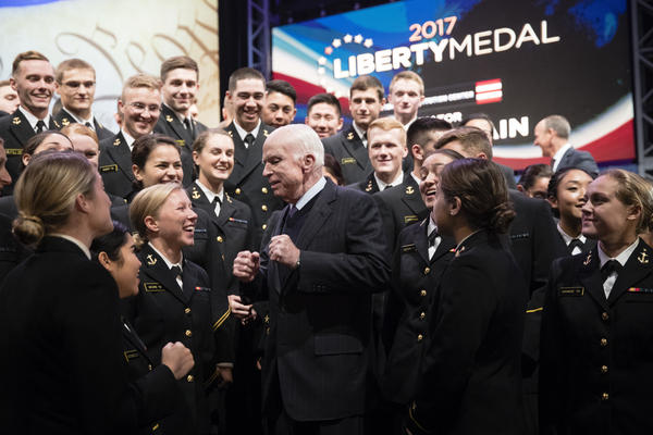 McCain meets with members of the United States Naval Academy Choir in 2017 after he received the Liberty Medal at the National Constitution Center in Philadelphia.