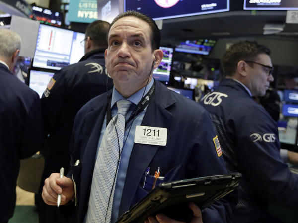 On the floor of the New York Stock Exchange, trader Tommy Kalikas looks on as stock indexes continued to fall Monday.