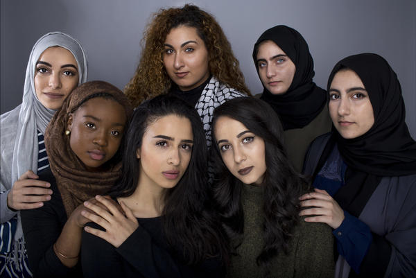 American Muslim college students in Ohio (front row: left to right) Halimah Muhammad (in brown hijab), Fatima Shendy, Zaina Salem, Ruba Abu-Amara, (back row: left to right) Arkann Al-Khalilee (in gray hijab), Nora Hmeidan and Lama Abu-Amara appear in an image that was featured in Uhuru, a Kent State University magazine in an issue on identity and race.