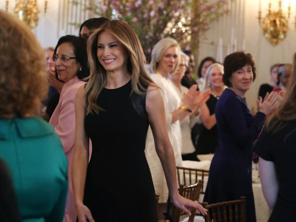 First lady Melania Trump arrives at a luncheon she was hosting to mark International Women's Day in the State Dining Room at the White House on March 8, 2017.