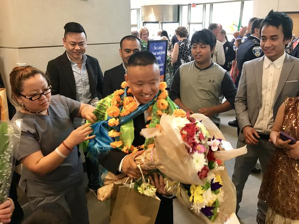 Damber Subba formally became a patrol officer with 11 other officers Friday night. He says the Bhutanese community embraces his appointment even before it was formalized.