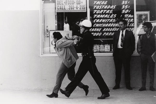 Los Angeles police arrest a Chicano student protester in the neighborhood of Boyle Heights in 1970. This image is seen on the cover to George Rodriguez's new book, <em>Double Vision.</em>