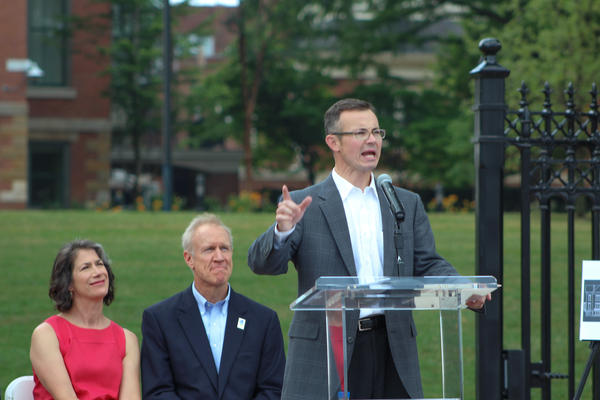 Justin Blandford, at podium, was recently named curator of the Illinois Governor's Mansion.