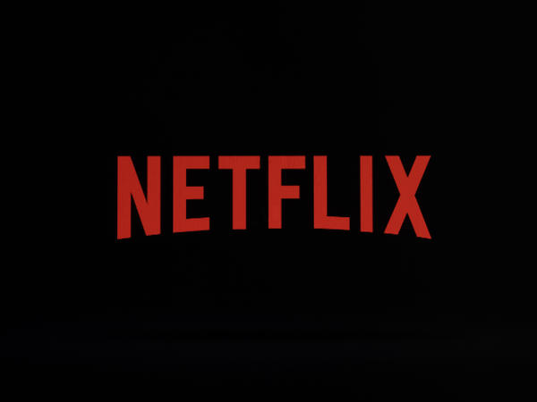A file photo from last year shows the Netflix logo on an iPhone in Philadelphia. The streaming service and production house fell short of its second-quarter target by more than a million subscribers, even as it posted better-than-expected earnings for the period.