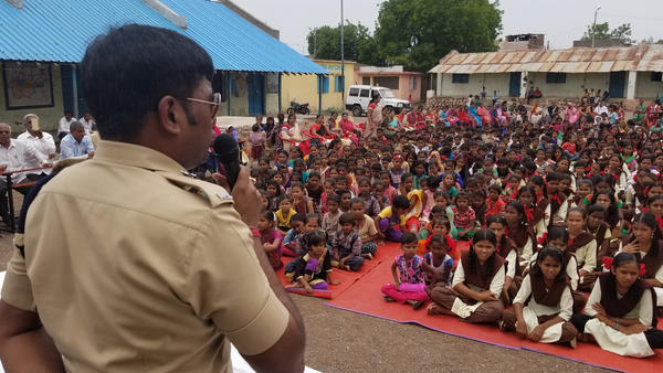 Harssh Poddar, a senior police official, addresses a village meeting at a rural school near Malegaon, in northern Maharashtra state. He warns families to be skeptical of what they read online. Earlier this month, Poddar helped rescue five people from being killed by a mob in his constituency.