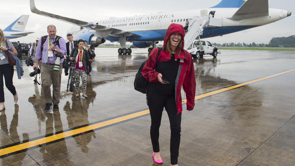 Beck Dorey-Stein, a former White House stenographer, walks with members of the White House press pool from Air Force One upon arrival at Wattay International Airport in Laos in  2016.