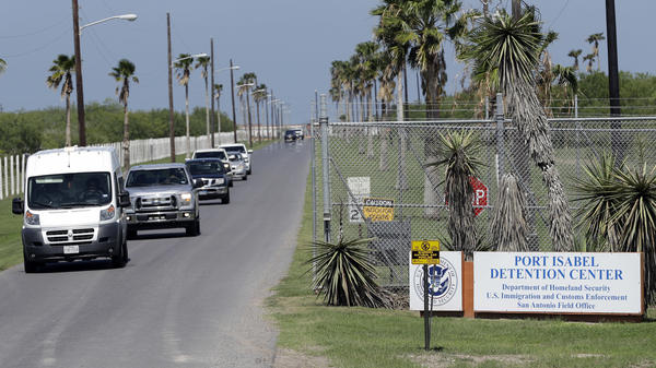 All day, unmarked white vans and chartered buses carrying the migrant children released from shelters across the country roll into the parking lot of the Port Isabel Detention Center in south Texas.