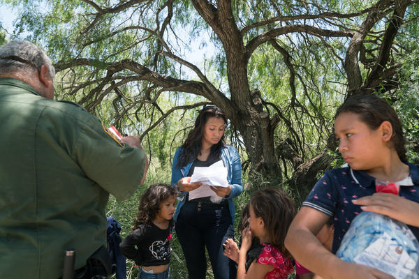 Dahani Gudiel, 25, from Guatemala turned herself and her three daughters in to the U.S. Customs and Border Protection outside of McAllen, Texas on Monday. Gudiel says she crossed the border seeking asylum after being threatened by gangs at home.