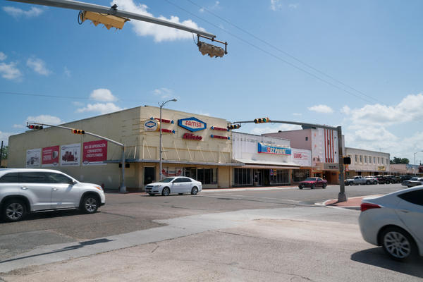 In once-bustling Raymondville, Texas, many businesses — from a historic movie theater to a Walmart — are no longer open.