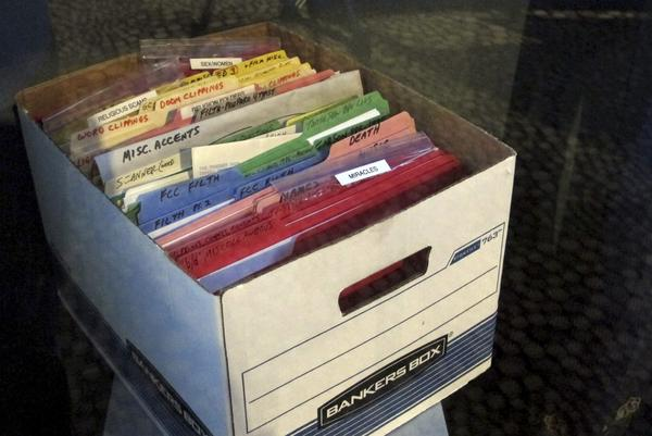 A file box full of notes is part of the George Carlin exhibit at the National Comedy Center in Jamestown, N.Y. Visitors to the center can explore the late comedian's archives of material, which the center acquired from Carlin's family. (Carolyn Thompson/AP)