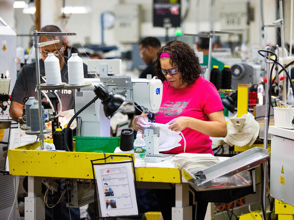 The job market is booming and the economy is expanding. But wage growth hasn't kept pace, which has many economists puzzled.
