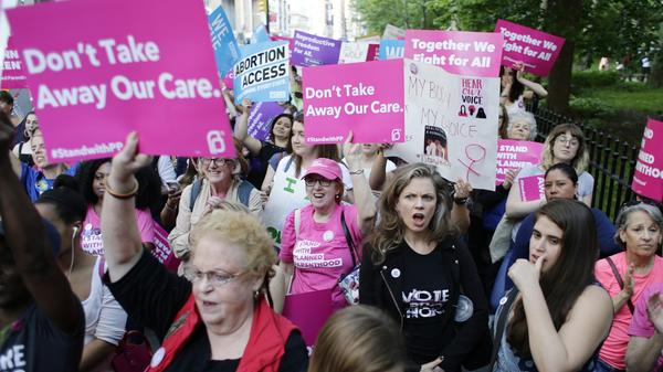 Supporters of Planned Parenthood react to speakers at a rally in New York in May.
