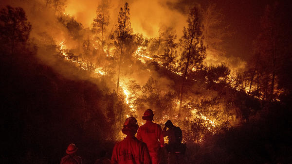 Firefighters monitor a backfire while battling the Ranch Fire, part of the Mendocino Complex Fire near Lodoga, Calif., on  Tuesday.