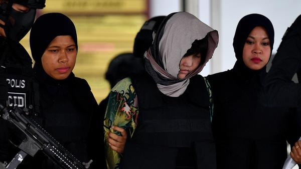 Vietnamese national Doan Thi Huong (center), escorted by armed Malaysian police, leaves after facing trial at the Shah Alam High Court outside Kuala Lumpur on Thursday.