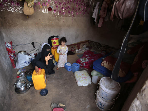 A Yemeni woman and a girl, displaced from the coastal city of Hodeidah, sit at a shelter in Sanaa, Yemen, on Aug. 17. Thursday's airstrike took place near Hodeidah.