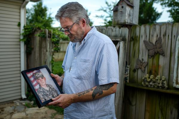David Toombs holds a photo of his son, John, at his home in Murfreesboro, Tenn. Former Sgt. John Toombs developed a drug problem after he left the Army and was in a residential treatment program at the Murfreesboro Veterans Affairs center. In 2016, he killed himself on the VA campus.