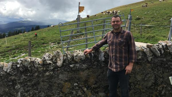 Dairy farmer Dominique Rochat says the Swiss government's water deliveries have allowed him to keep his cows in the high mountains.