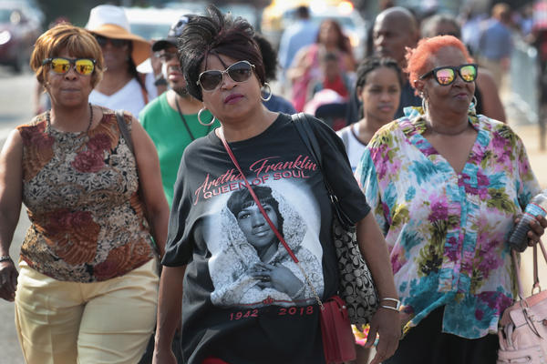 Fans of Aretha Franklin attend a viewing for the soul music legend at the Charles H. Wright Museum of African American History on Tuesday in Detroit.