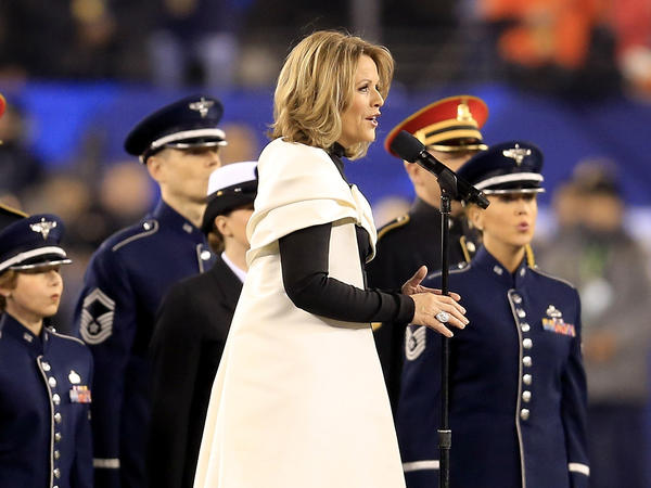 Renée Fleming, photographed singing the national anthem during Super Bowl XLVIII, will sing at the memorial service for the late Sen. John McCain at Washington's National Cathedral.