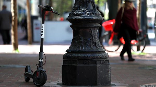 A Bird scooter sits parked on a street corner in San Francisco. Dockless scooters have become very popular across the U.S., but many people say they're a nuisance.