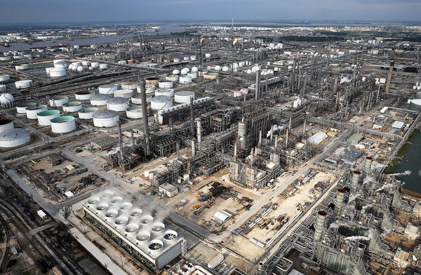 Petrochemical facilities in the Houston area are assessing their hurricane preparedness after Hurricane Harvey. This oil refinery reinforced storage tank roofs with geodesic domes —  the gray caps on some of the white tanks in the photo — to better withstand a deluge.