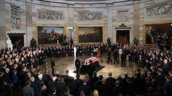 The flag-draped casket of Sen. John McCain arrives inside the Rotunda of the U.S. Capitol on Friday.