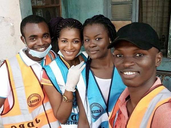 Chris Junior Anaekwe, right, with three volunteers. They picked up trash in their city of Onitsha, Nigeria, for World Environment Day on June 5.