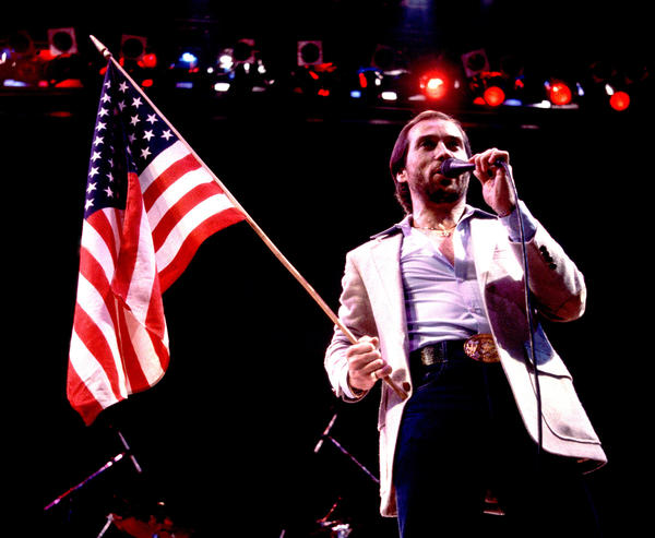 """Lee Greenwood performs in Illinois in 1984. Released that spring to a modest chart showing, """"God Bless the U.S.A."""" found staying power as political campaigns began to adopt it."""