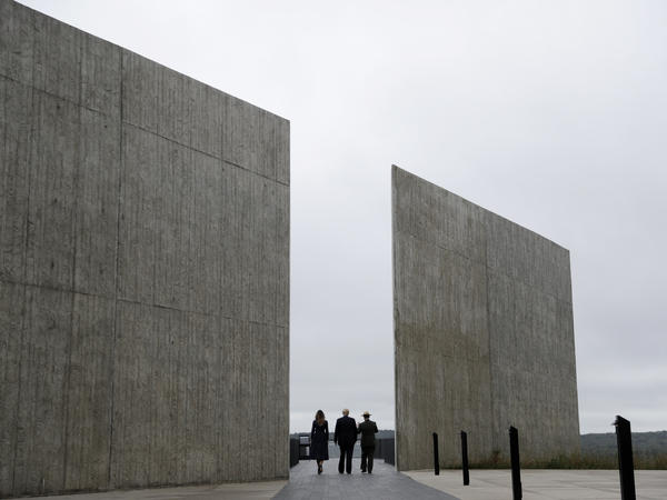 President Trump, first lady Melania Trump and Stephen Clark, the superintendent of the National Parks of Western Pennsylvania, walk through the Flight 93 National Memorial in Shanksville, Pa., on Tuesday.