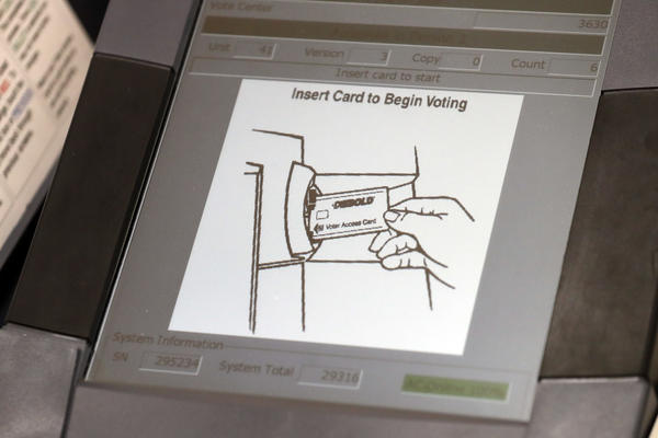 A touchscreen voting machine in Sandy Springs, Ga., during the primary election in May 2018. As the midterm congressional primaries heat up amid warnings of Russian hacking, about 1 in 5 Americans will be casting their ballots on machines that do not produce a paper record of their votes.