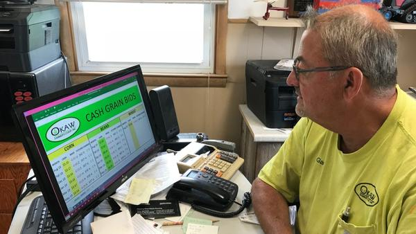 Gary Smith tracks the Chicago Board of Trade's corn, soy and wheat prices at his office in the Okaw Farmer's Co-op in Lovington, Illinois.