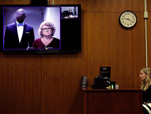 Ex-Michigan State University women's gymnastics coach Kathie Klages appears with her attorney Takura Nyamfukudza at a video arraignment after turning herself in to police in August.