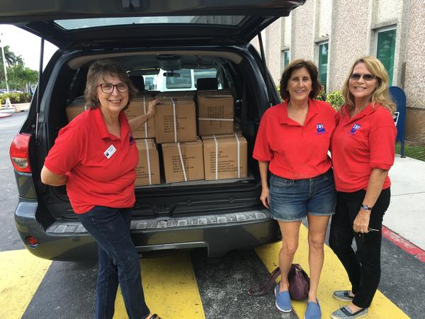 Volunteers from the League of Women Voters in Broward County pick up 5,000 gun locks from the Miami VA hospital