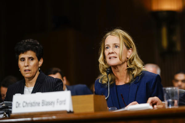 Ford, with lawyer Debra S. Katz, answers questions.