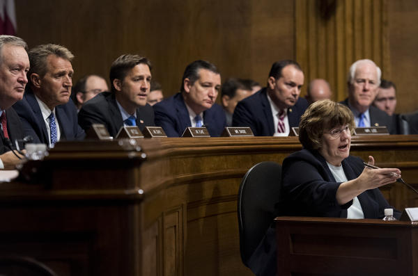 Phoenix prosecutor Rachel Mitchell questions Ford as Republican Sens. Mike Crapo (from left), Jeff Flake, Ben Sasse, Ted Cruz, Mike Lee and John Cornyn listen.