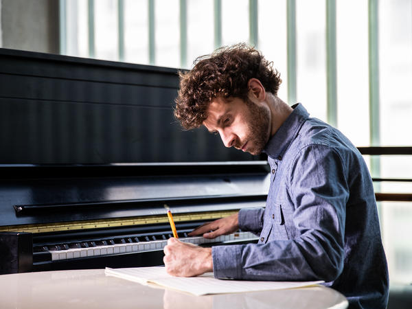 """Matthew Aucoin, 28, has been awarded a MacArthur """"genius"""" grant for his work as a composer and conductor."""
