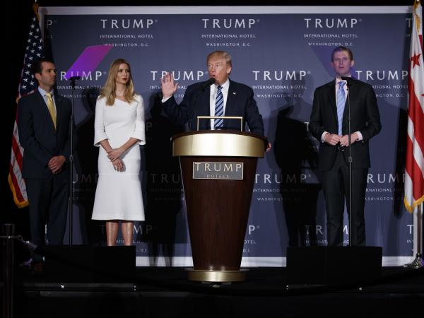 Donald Trump, accompanied by Donald Trump Jr. (from left), Ivanka Trump and Eric Trump at an event in 2016. New York Attorney General Barbara Underwood says the younger Trumps had exercised no real control over the Trump Foundation's activities, despite being nominal board members.