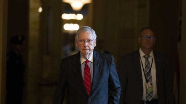 Senate Majority Leader Mitch McConnell of Kentucky walks to the Senate floor for a vote on Thursday.