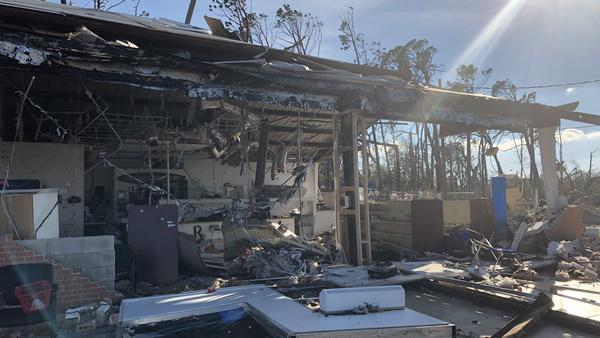 The walls and windows of this pharmacy in Lynn Haven, Fla., were blown out during Hurricane Michael, but pill bottles remained lined up on the shelves. The city saw widespread damage from Hurricane Michael, including roofs blown off and fallen trees.