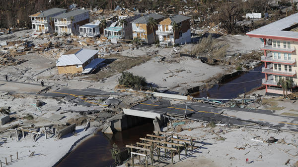 A bridge damaged by Hurricane Michael can be seen Friday in Mexico Beach, Fla. The most powerful hurricane ever known to have hit the Florida Panhandle has left transportation and communication infrastructure in shambles, slowing relief efforts.
