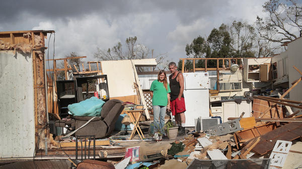 Cynthia Lamphier and Chet Bundy pose for a picture in the kitchen of the trailer home they were in when it was destroyed by Hurricane Michael.