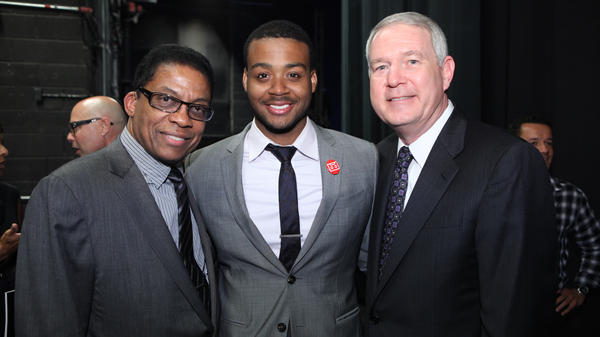 Kris Bowers, the last pianist to win the Thelonious Monk International Jazz Competition, stands between Herbie Hancock, left, and Tom Carter, president of the Thelonious Monk Institute, at right — photographed during the Competition Gala on September 12, 2011 in Washington, D.C.
